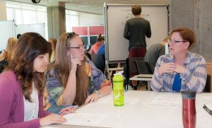 Students put heads together at Learning Commons PLUS groups in JFK Library