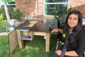 Puneet Janda with the MC charge station she engineered.