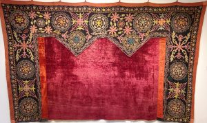 rectangular tapestry, top and sides embroidered with intricate designs