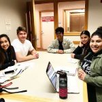Pathways students and mentors smiling in study room