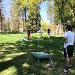 Pathways students playing Cornhole outside