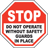 warning sign about not operating machinery without the safety guards in place