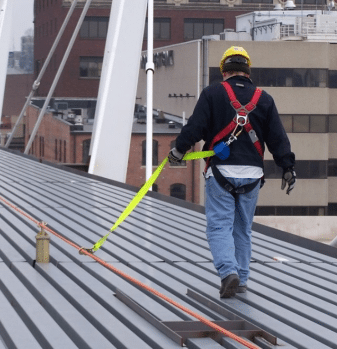 Image of a person on a roof using fall protection