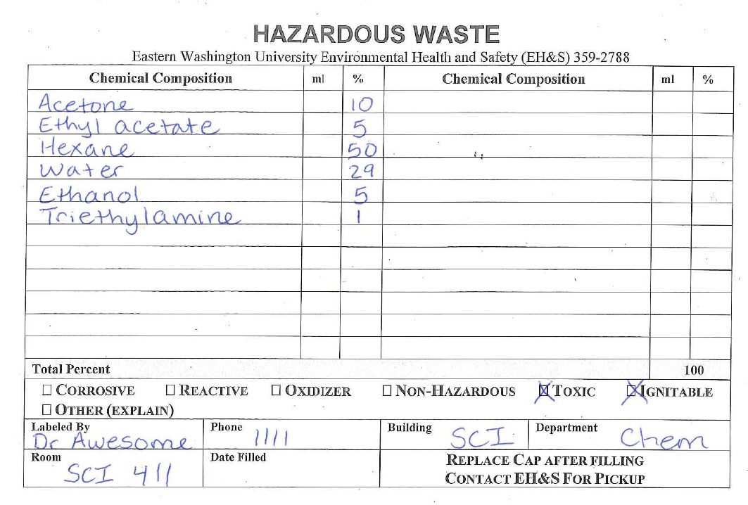 Example hazardous waste label with components hand written.