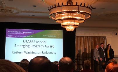 Director Bruce Teague Accepting USASBE Award