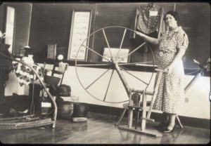 woman with historical household items